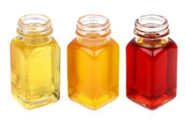 Three bottles with oils close up isolated on white