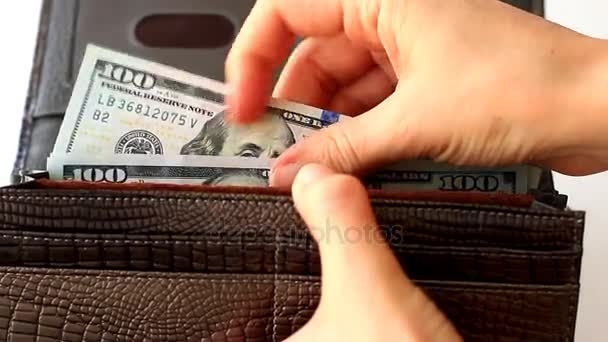 Female hands counting one hundred dollar bills in wallet
