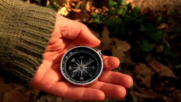 Navigation compass in hand of girl