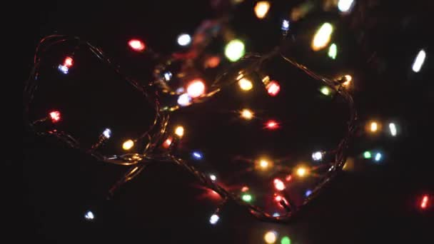 Abstract background for christmas holiday. Multi-colored LED lights on the table.