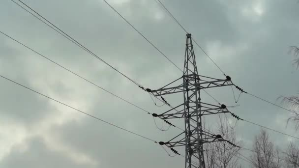The rapid movement of gray clouds on the background of power lines.