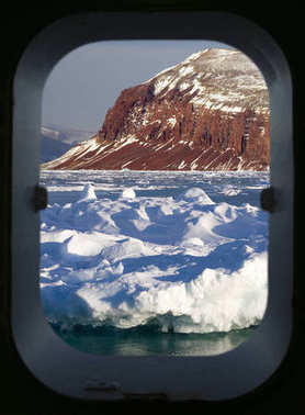 Arctic scenery through a ships porthole
