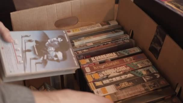 VHS sale of vintage movies on video cassettes at a flea market