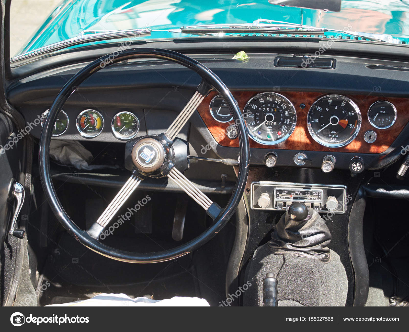 Collectors meeting of classic cars and motorbikes. Steering wheel ...