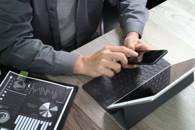 top view of businessman hand using smart phone,mobile payments o