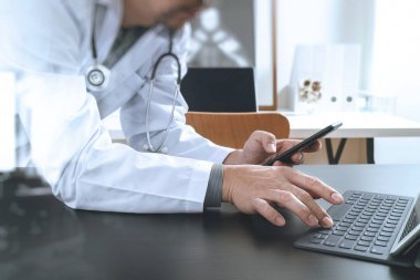 Medical technology concept. Doctor working with smart phone and