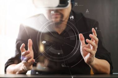 businessman wearing virtual reality goggles in modern office wit