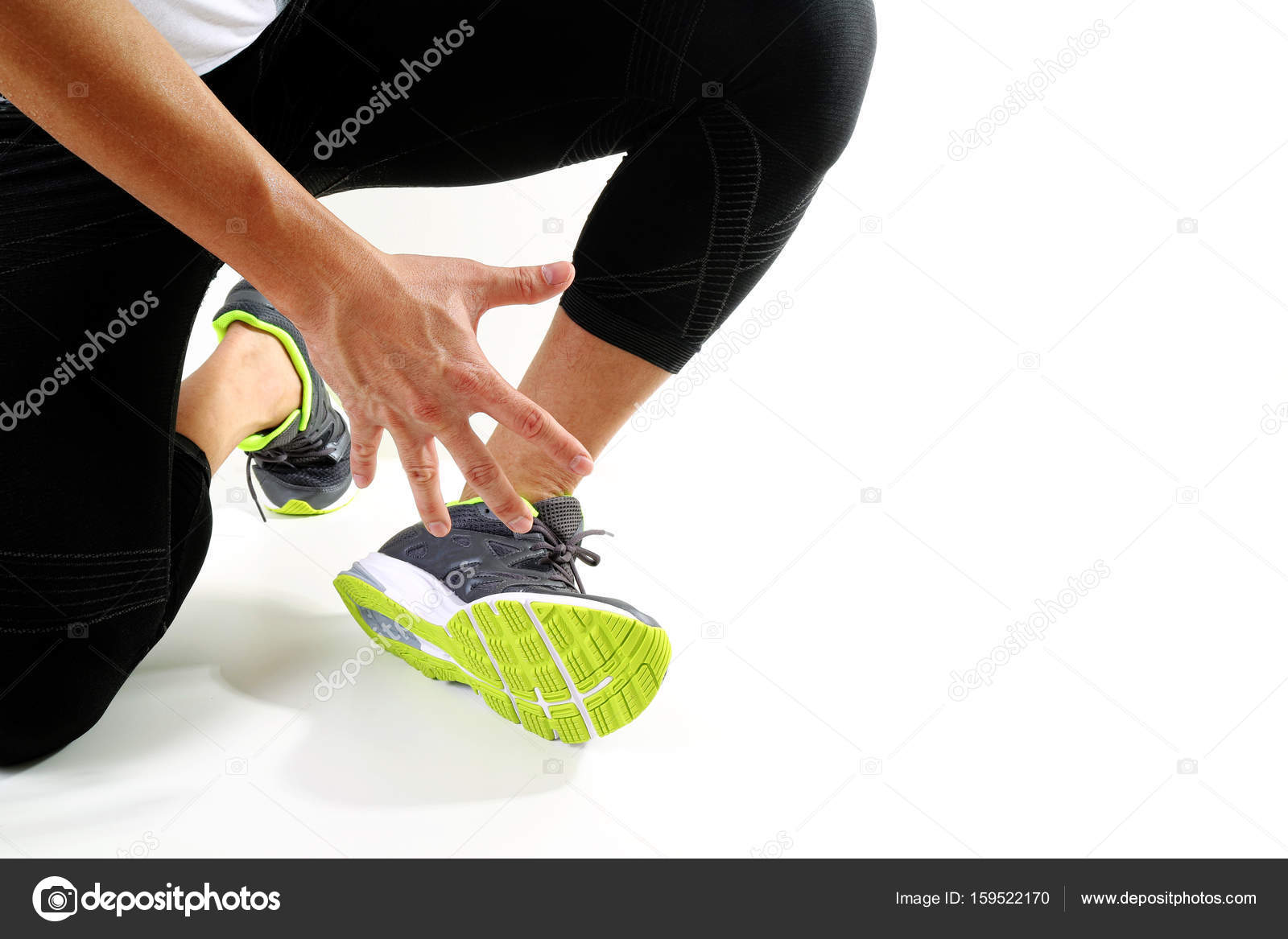 Runner sportsman holding ankle in pain with Broken twisted