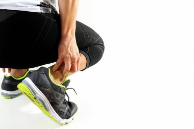 Runner sportsman holding ankle in pain with Broken twisted joint
