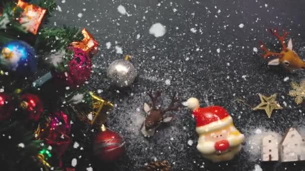 Greeting Season concept.Gimbal shot of ornaments on a Big Christmas tree with decorative light and falling snow in 4k (UHD)