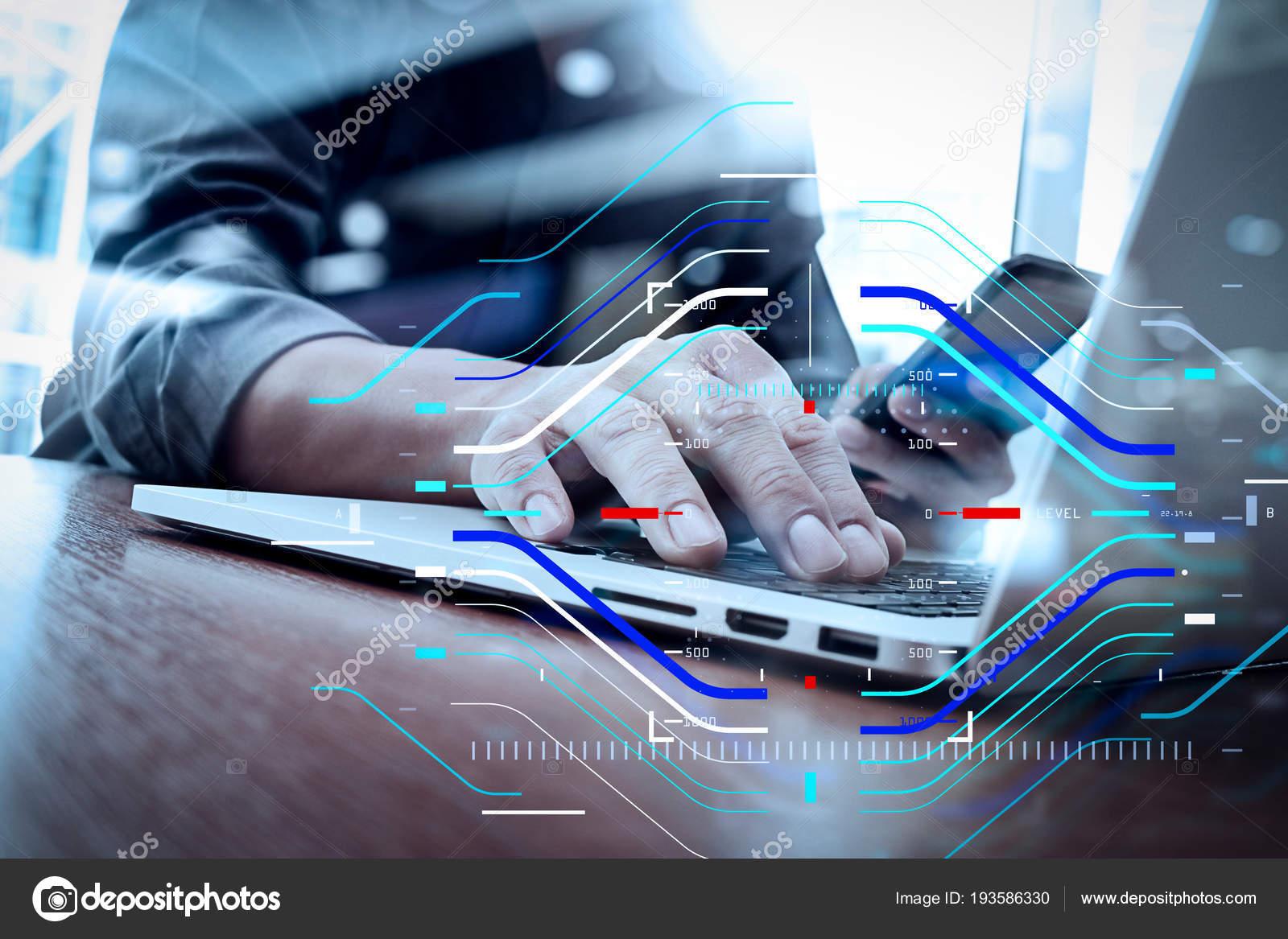 Trabalho de mo designer e telefone inteligente e laptop na mesa de conceito de foco no alvo com diagramsigner digital mo trabalhando e inteligente telemvel e do laptop na mesa de madeira no escritrio com background de ccuart Image collections