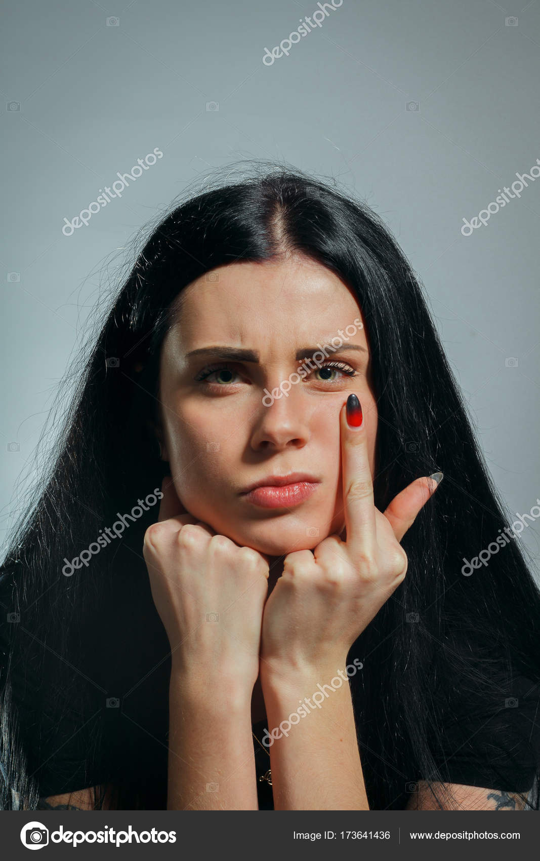 Bad girl showing fuck off– stock image