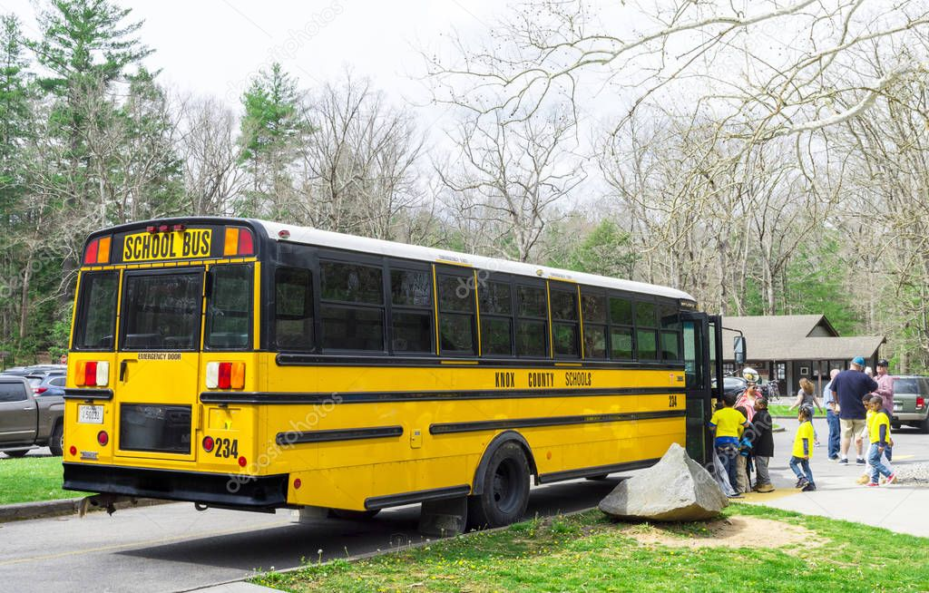 Knox County School bus picking up students in the Cades Cove Campground in the Great Smoky Mountains National Park