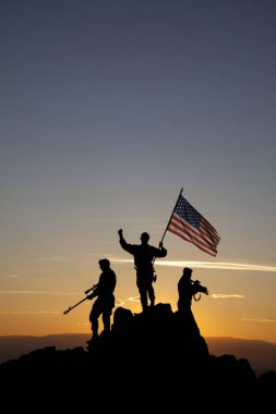 Three armed soldiers with American flag on the top of the mountain stock vector