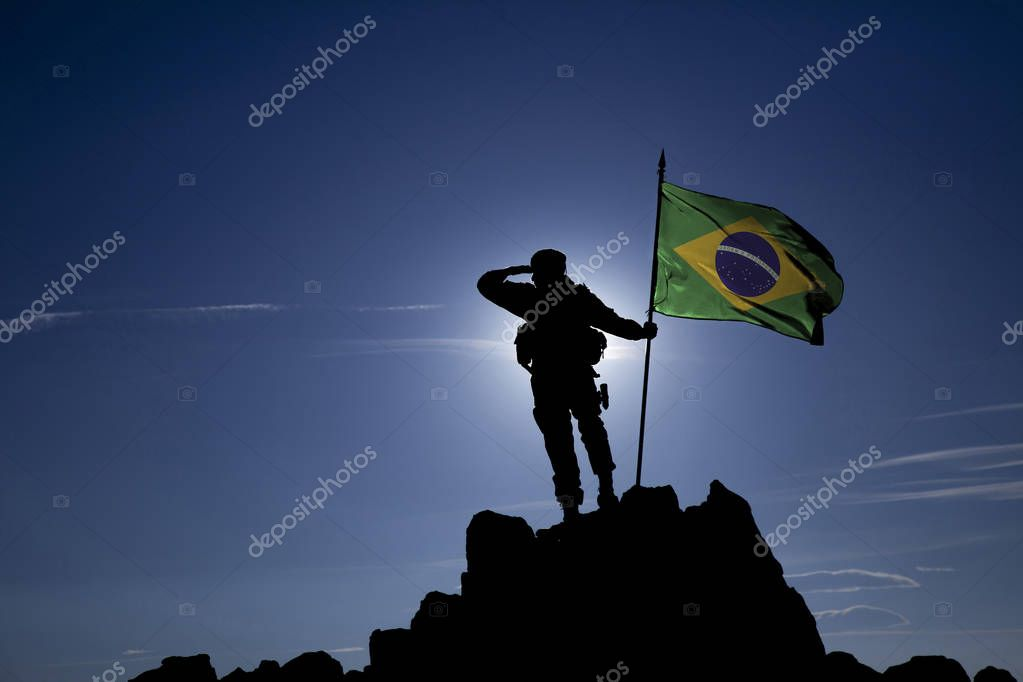 Soldier on the top of a mountain with a Brazilian flag stock vector