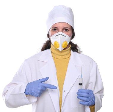 concept. Female doctor in mask  holding syringe  over white back