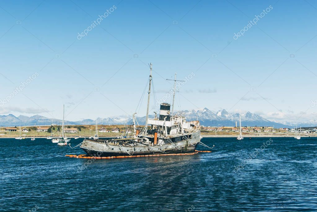 Shipwreck in the Ushuaia harbor with a dramatic sky in the background, Ushuaia Tierra del Fuego Argentina