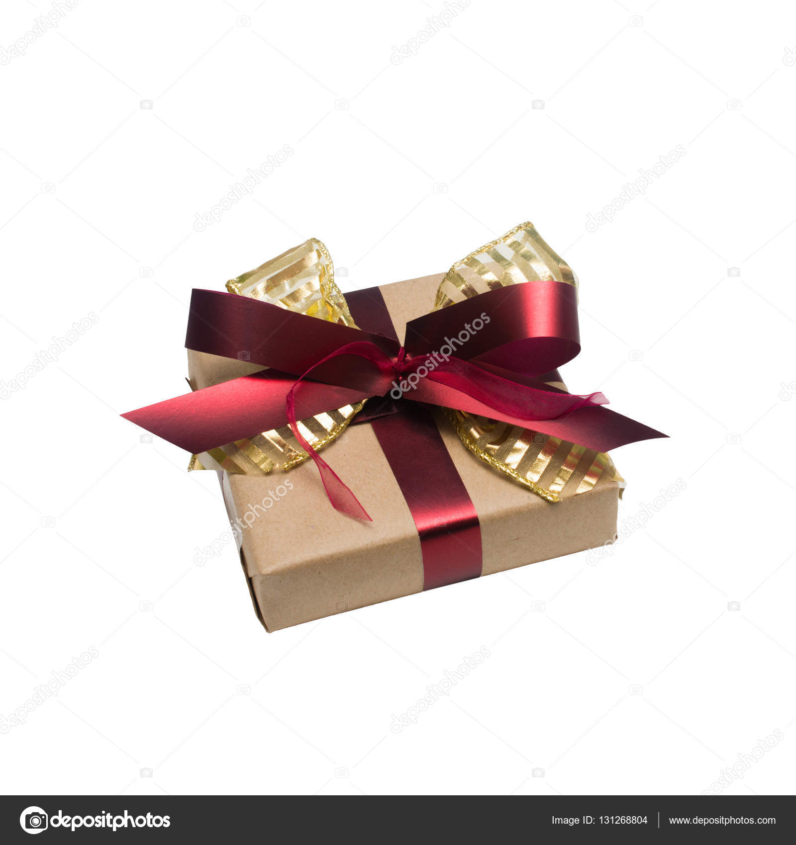 Wrapped vintage gift box with red ribbon bow — Stock Photo