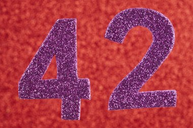 Number forty-two purple color over a red background. Anniversary