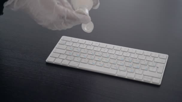 Disinfection. Precautions for the epidemic of the virus. Coronavirus quarantine. Hands in latex gloves wipe the computer keyboard with a disinfector. Surface treatment with alcohol. Stay home.Outbreak