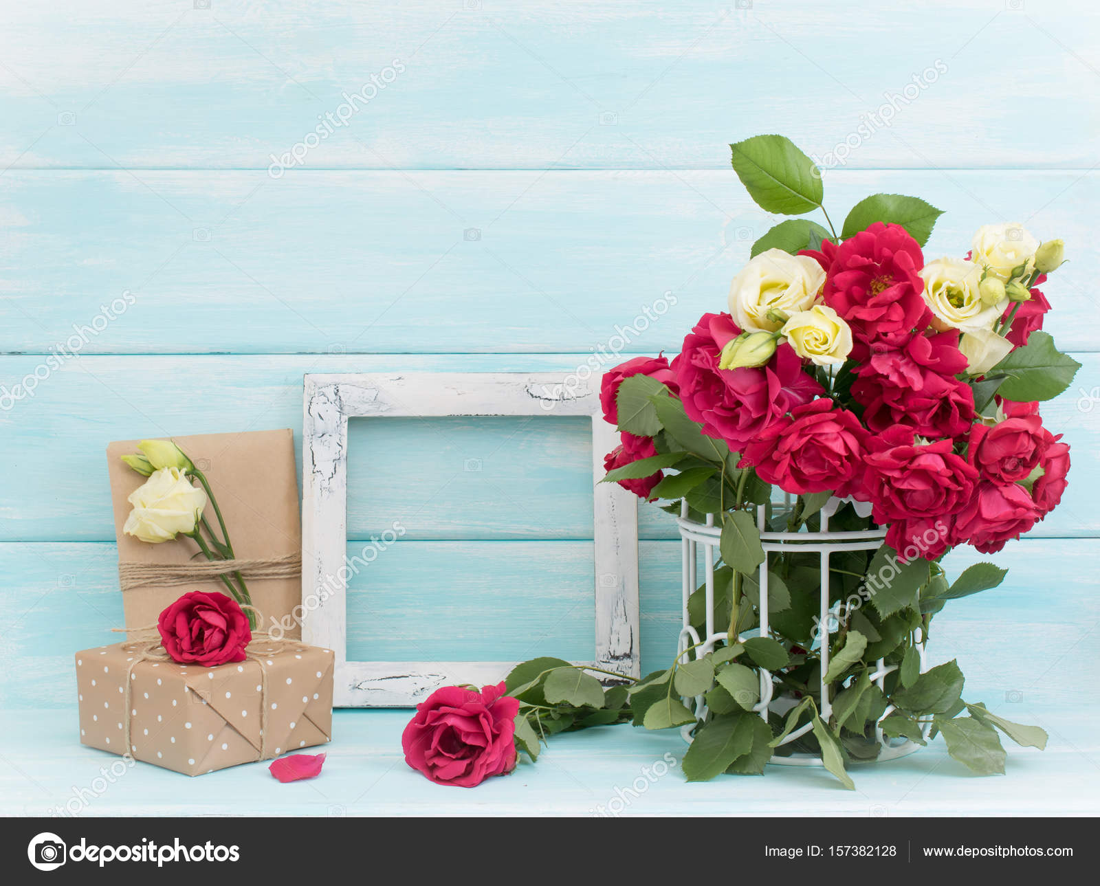 Roses in birdcage, photo frame and gifts — Stock Photo © Julia_Arda ...