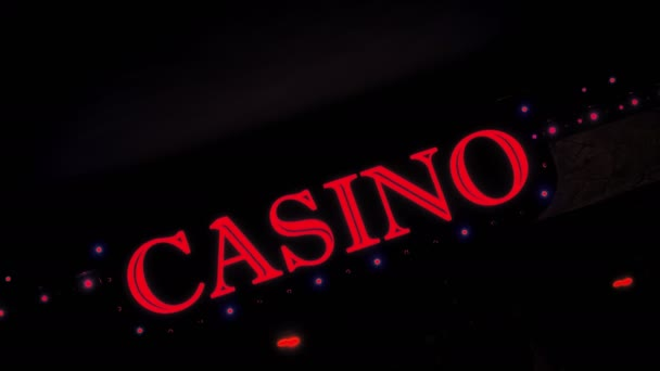 Red Casino Sign With Flashing Lights at Entrance to Casino Glows in Dark