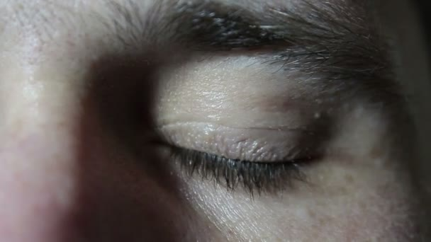 Gray-green eye of a young handsome guy close up. Eye Close-up.