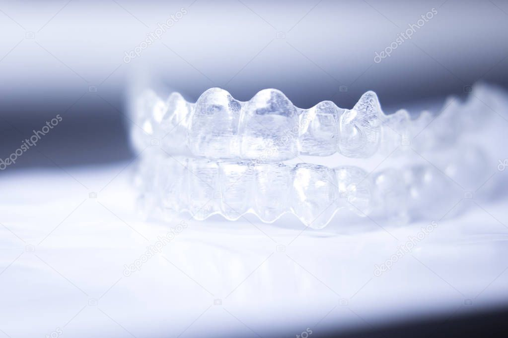 Invisible teeth aligners