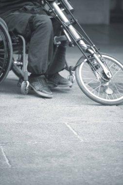 Man in wheelchair on sidewalk