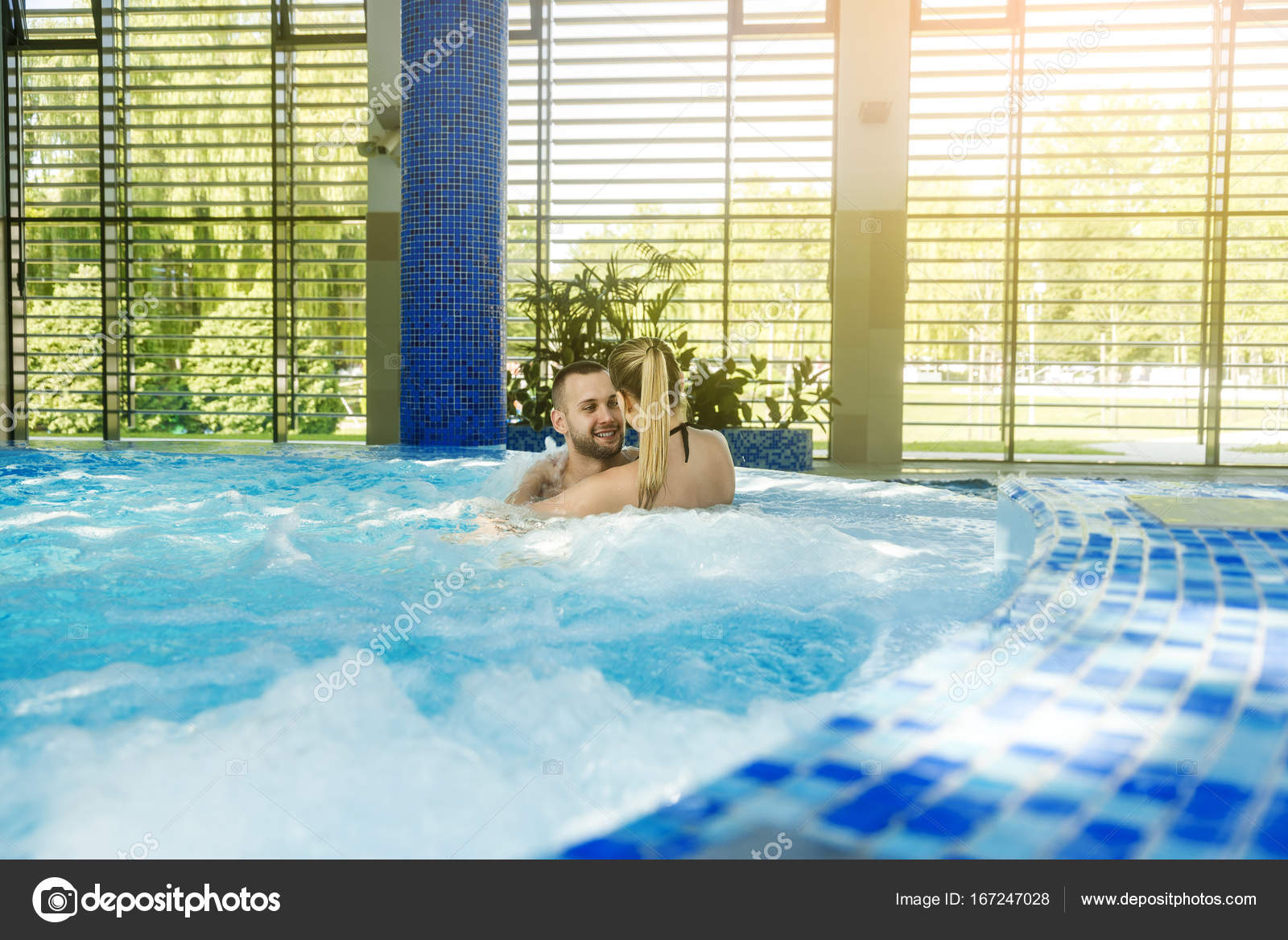 Romantic couple enjoying thermal bath spa and wellness center ...