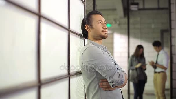 young asian entrepreneur thinking in office