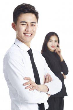 young asian businessman and female colleague