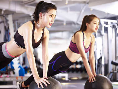 young asian women exercising with medicine balls
