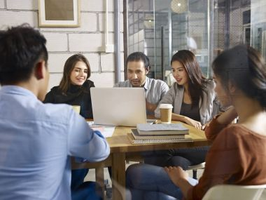 group of young business people meeting in company