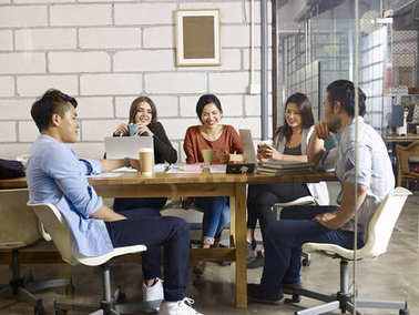 team of asian and caucasian entrepreneurs meeting in office