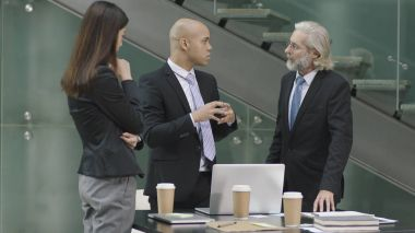 three coporate executives meeting in office