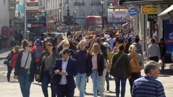 Crowds of People Walking in City Centre of London, UK - June 2019
