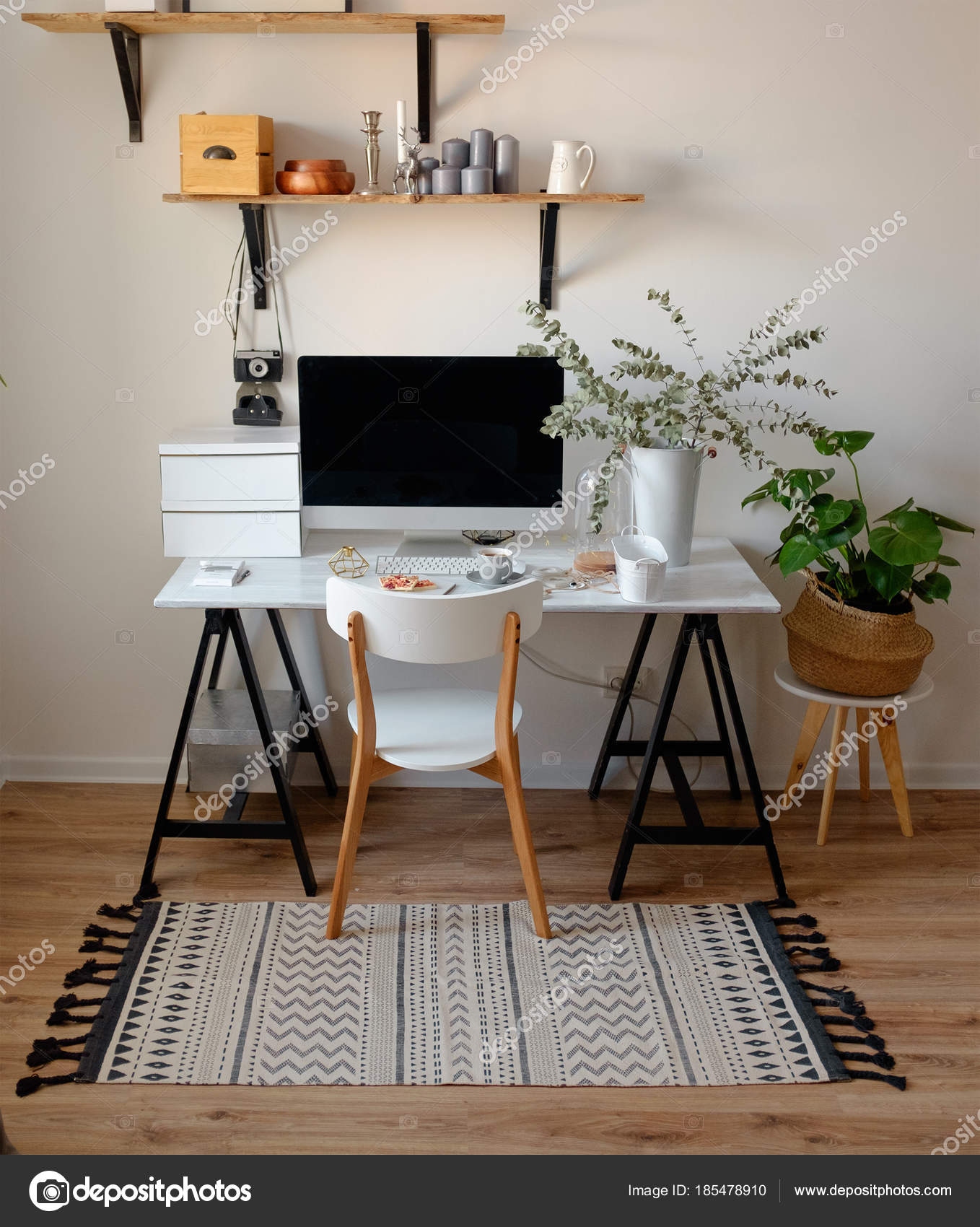 A Chic Workplace In Scandinavian Style White Chair On The Computer Table And Eucalyptus Pot Wooden Shelves With Decor Photo By Olegsamoylov