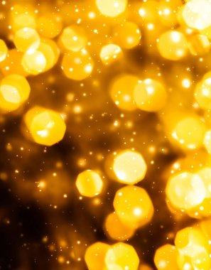 Glamorous gold shiny glow and glitter, luxury holiday background