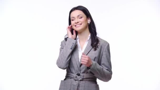 Businesswoman with earphones dancing isolated on yellow