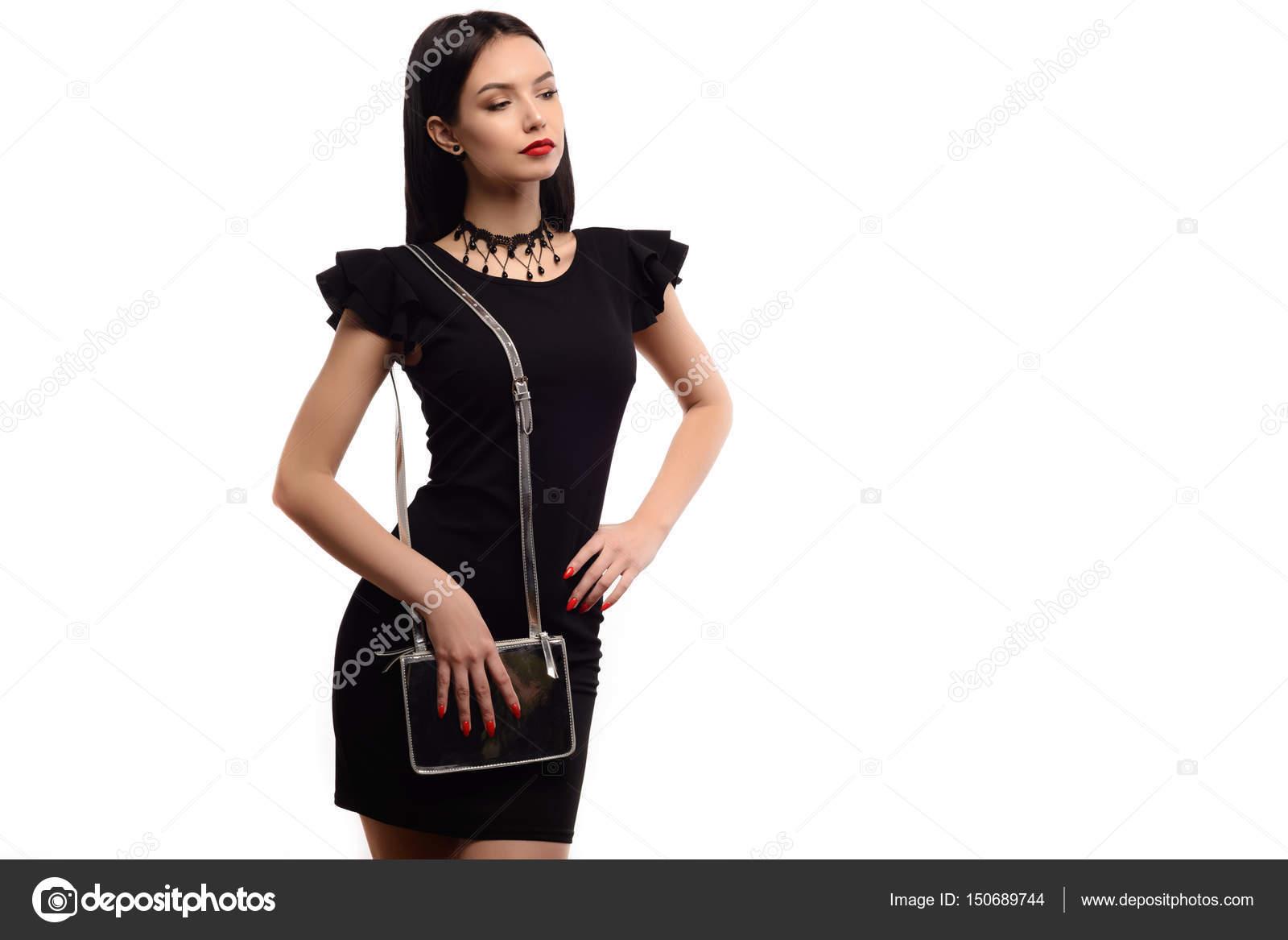 pretty nice ff162 5222b Chiuda sulla donna elegante in vestito nero con piccola ...