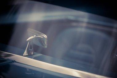 Rear view mirror of a vintage car