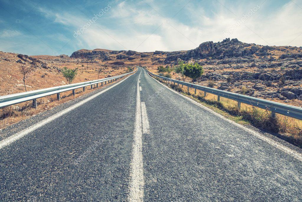 Long Empty Desert Asphalt Road