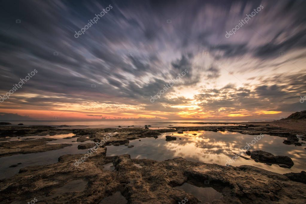 Reflections.Magnificent long exposure sea sunset landscape.