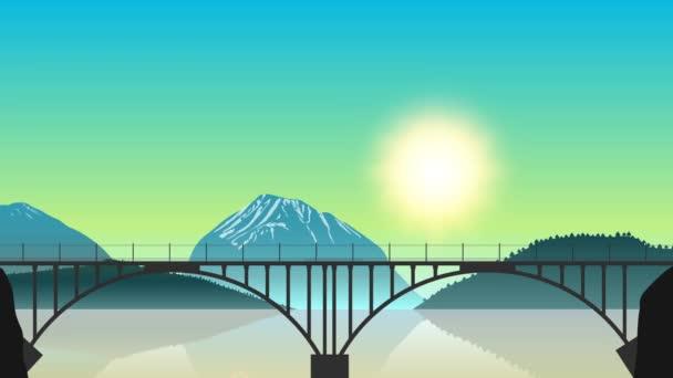 Jedoucí nákladní vlak na mostě v pozadí horské krajiny za svítání