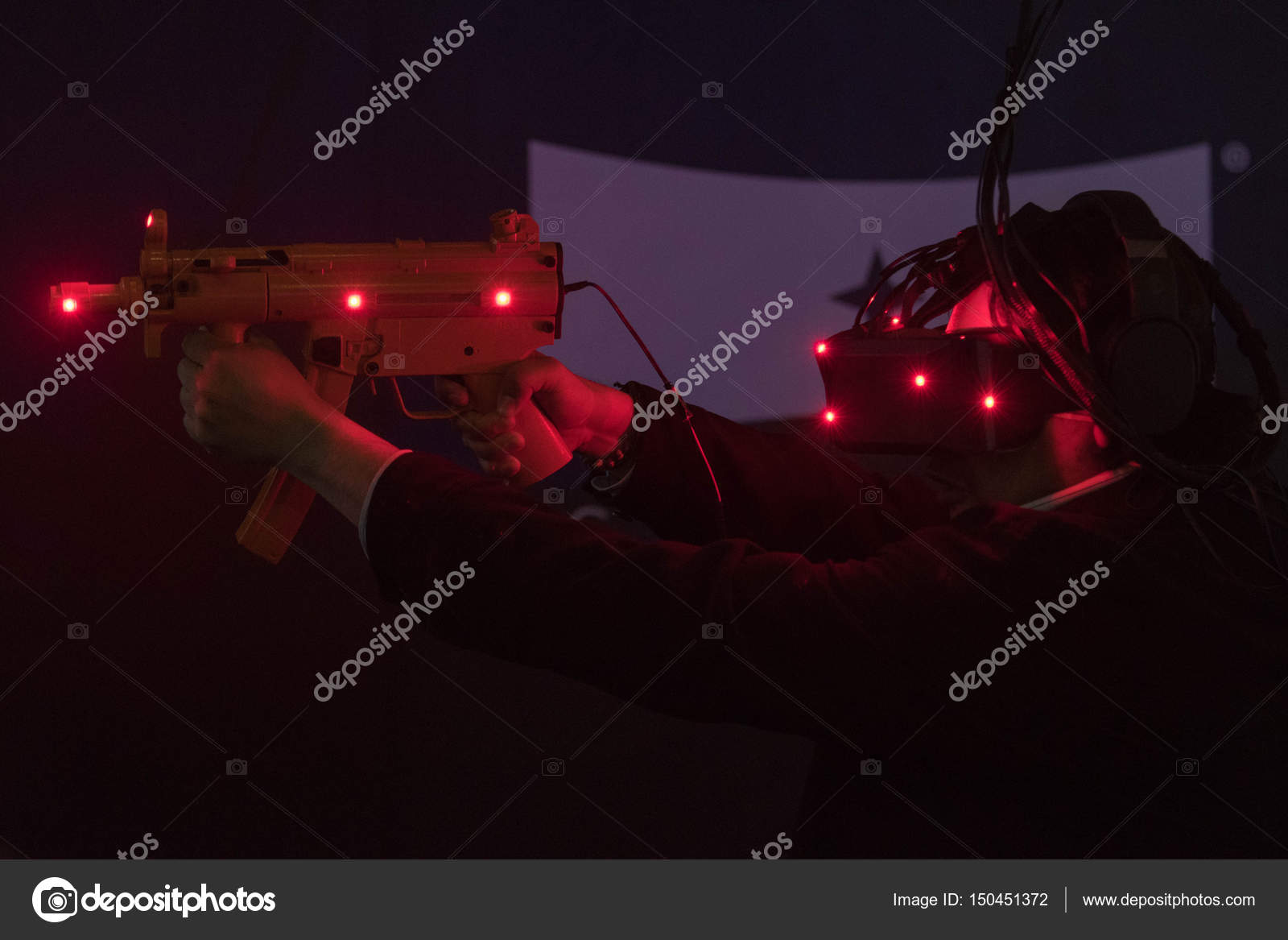 Close-up of man using vr glasses and weapon gun – Stock Editorial