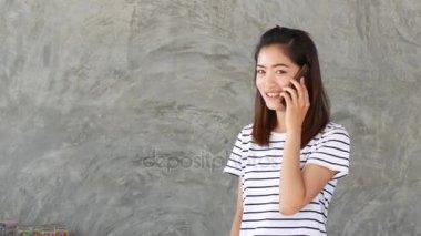 Portrait of beautiful girl using telephone