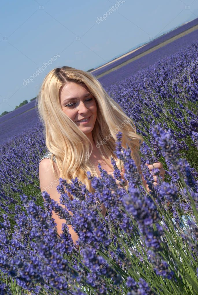 Woman posing in lavender field, Provence, Valensole, France