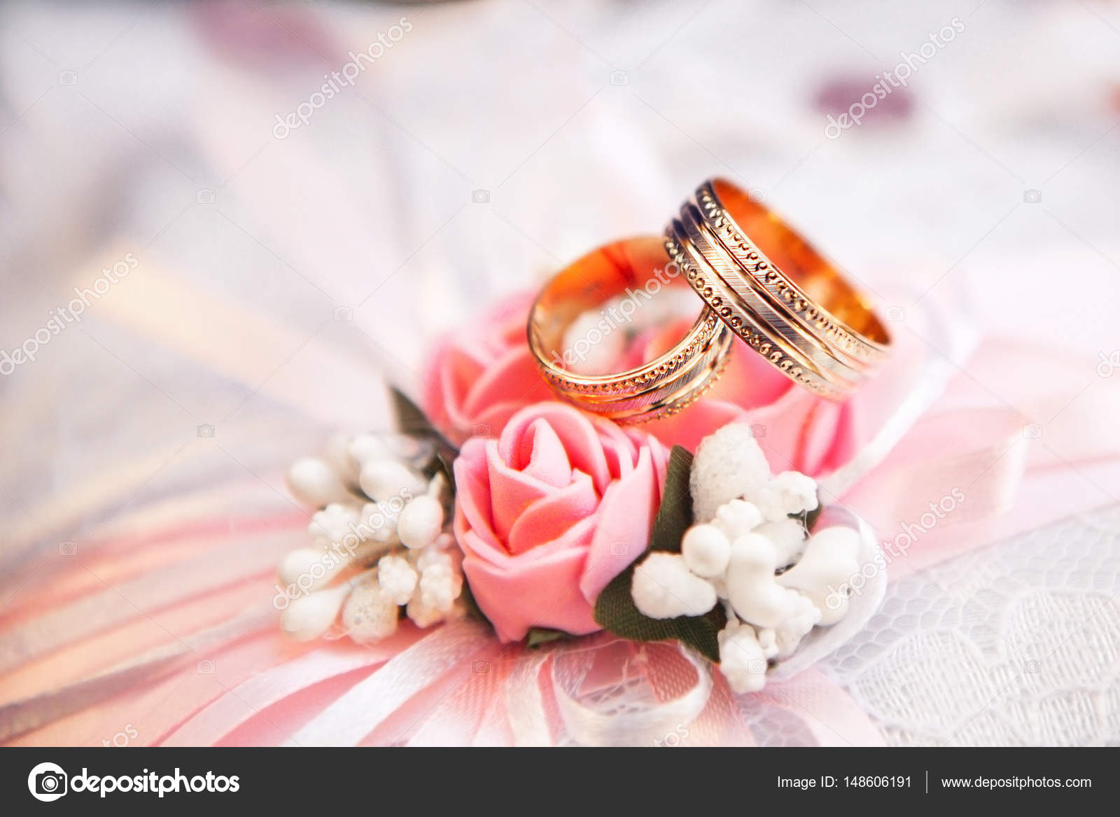 Gold wedding rings lie on a flower bud red — Stock Photo © style ...