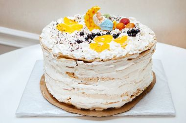 summer cake with fruit from orange, kiwi, currant for celebration